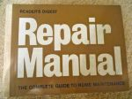 An old Reader's Digest Repair Manual-got to make sure he's doing it right...