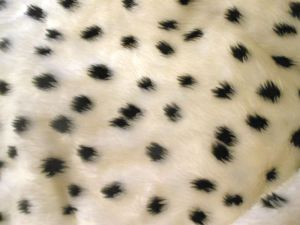 I LOVE this spotty faux fur fabric. BigSmall wants me to make him some ears before it gets sold!