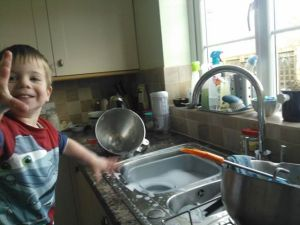 "Does anyone else remember when ""helping"" with the washing up was this much fun (and necessitated a change of clothes…)?!"