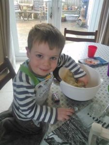 Making Smartie Cookies with my 'helper'